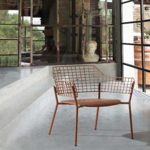assise lounge en acier laqué ajouré cuivré style vintage